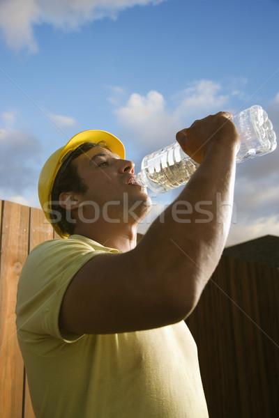 água potável vista lateral masculino caucasiano bebidas Foto stock © iofoto