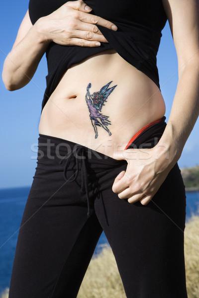 Vrouw fairy tattoo kaukasisch maag vrouwen Stockfoto © iofoto