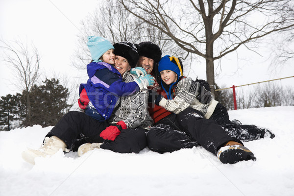 Family sitting in snow. Stock photo © iofoto