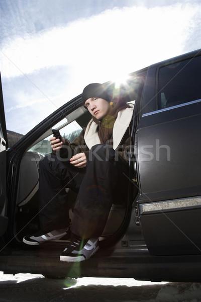 Teen sitting in car. Stock photo © iofoto