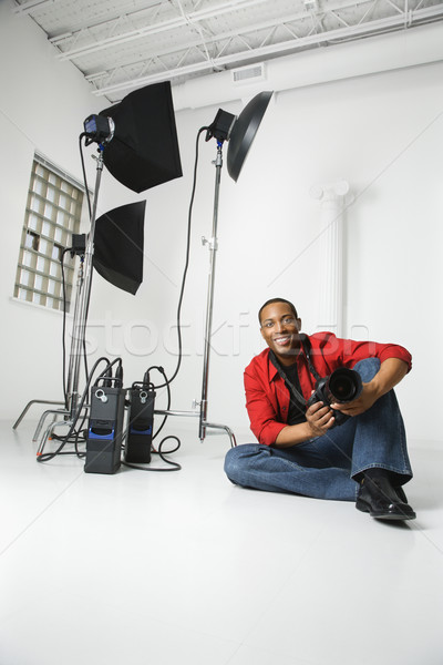 Photographer in studio. Stock photo © iofoto