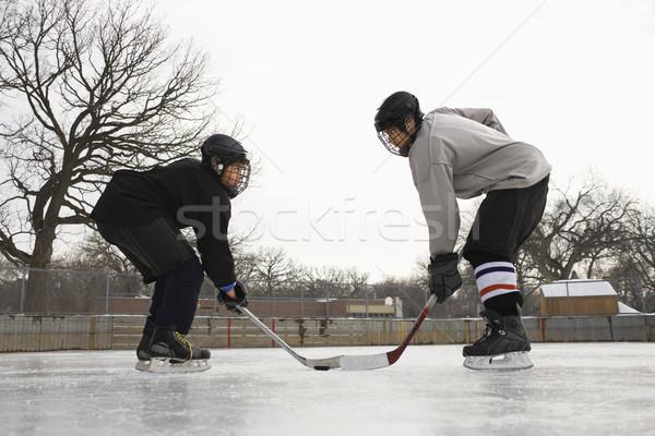 Jégkorongozó arc el kettő jégkorong játékos Stock fotó © iofoto