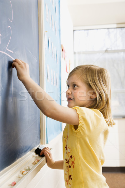 Stock photo: Girl Writing on Blackboard