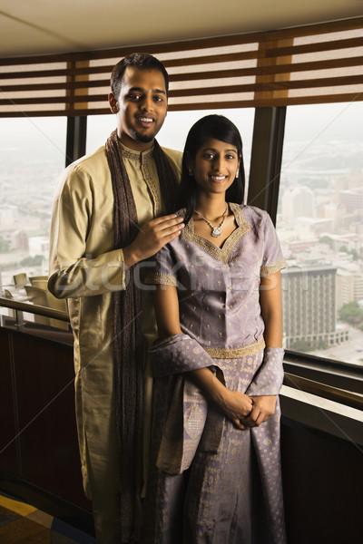 Fiatal felnőtt pár magas ablakok portré áll Stock fotó © iofoto