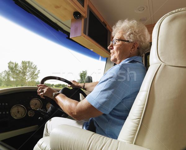 Senior woman driving RV. Stock photo © iofoto