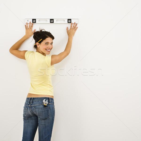 Woman leveling wall. Stock photo © iofoto