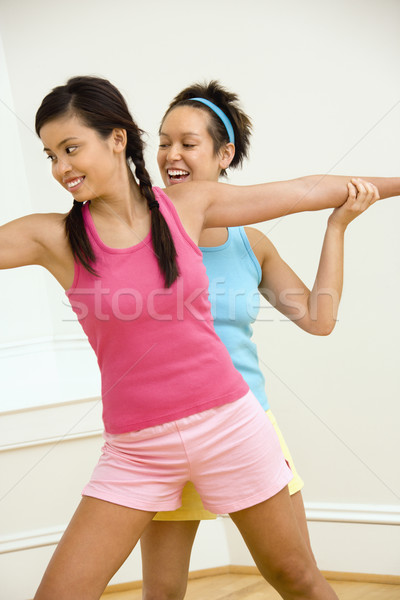Smiling women doing yoga Stock photo © iofoto