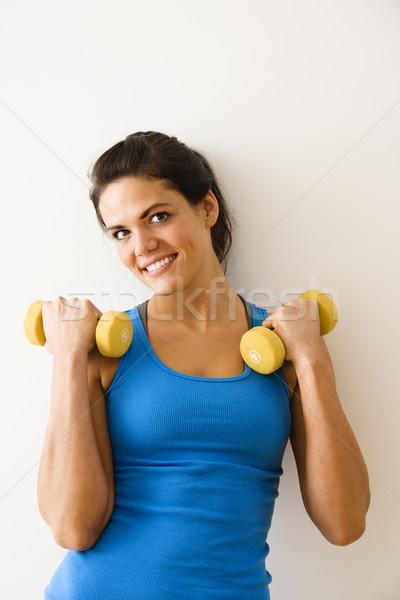 Kobieta trening siłowy strony wagi uśmiechnięty Zdjęcia stock © iofoto