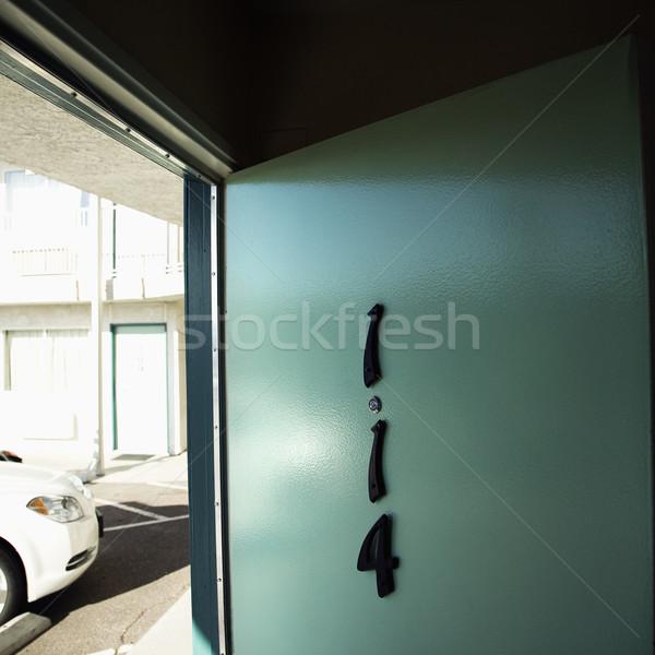 Groene motel deur kamer eerste vloer Stockfoto © iofoto
