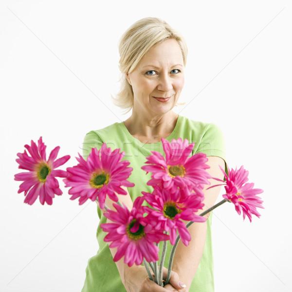 Donna fiori ritratto sorridere adulto donna bionda Foto d'archivio © iofoto