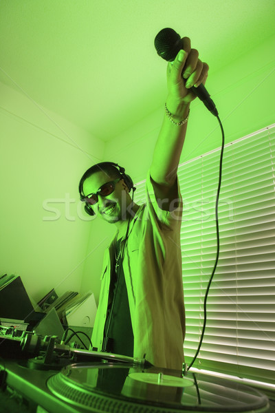 Male deejay smiling. Stock photo © iofoto