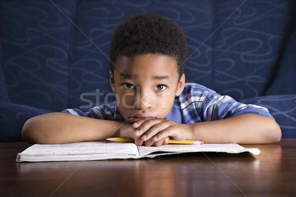 Chłopca praca domowa młodych piętrze stolik Zdjęcia stock © iofoto