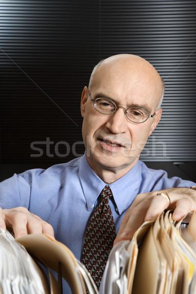 Foto stock: Empresário · arquivos · caucasiano · olhando · homem