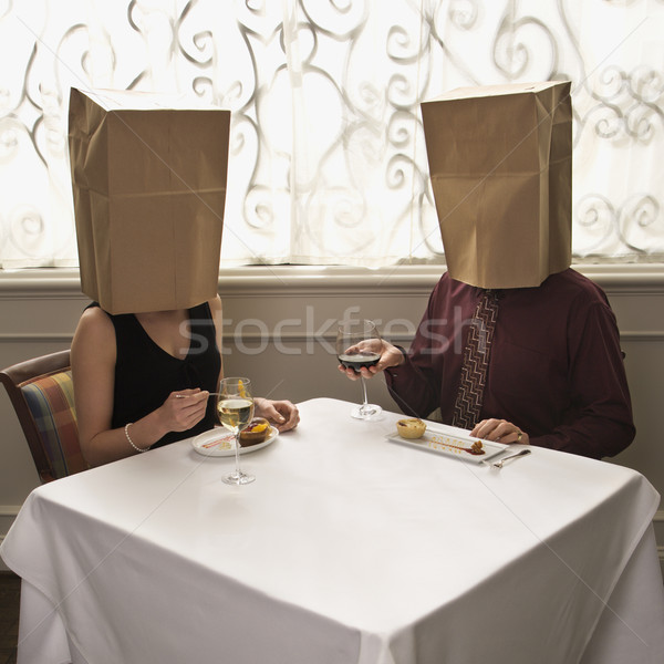 Stock photo: Couple wearing bags.
