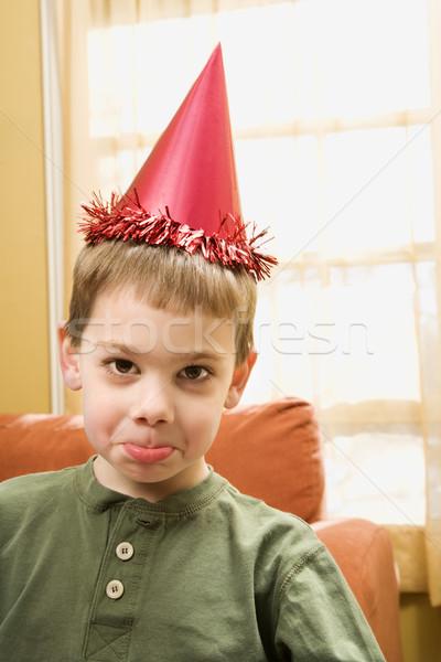Garçon fête chapeau regarder Photo stock © iofoto