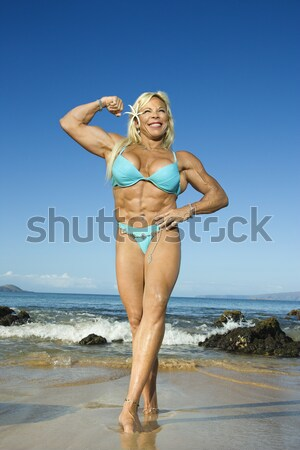 Woman in Swimsuit Standing on Beach Stock photo © iofoto
