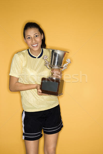 Smiling girl holding trophy. Stock photo © iofoto