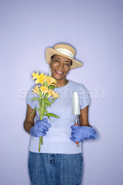 Woman with gardening tools. Stock photo © iofoto