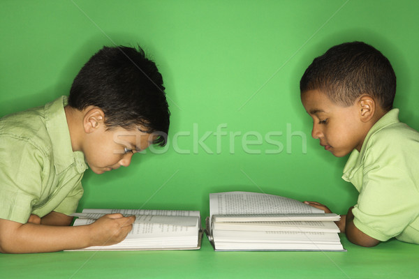 Boys lying and reading. Stock photo © iofoto