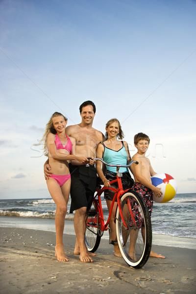 Family walking down the beach. Stock photo © iofoto