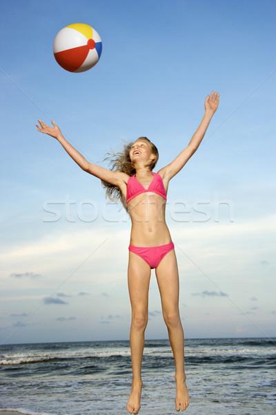 Lány játszik strandlabda kaukázusi tengerpart gyermek Stock fotó © iofoto