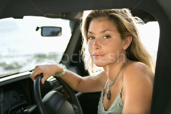 Blonde Woman Sitting in Car Stock photo © iofoto