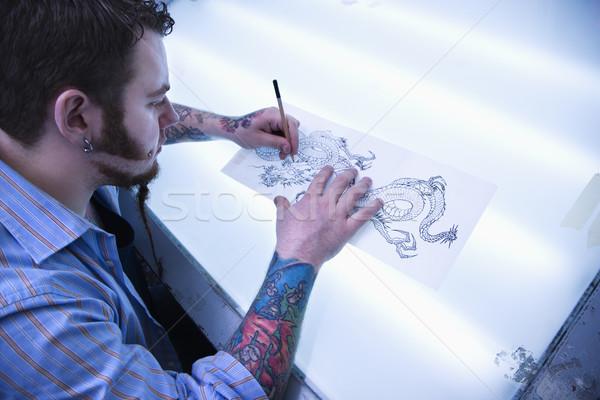 Man designing tattoo. Stock photo © iofoto