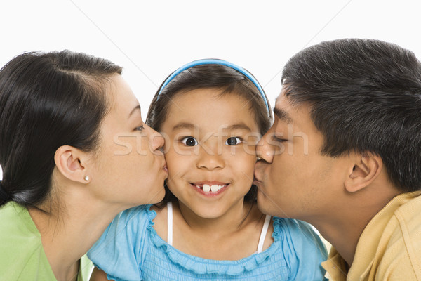 Parents kissing daughter. Stock photo © iofoto