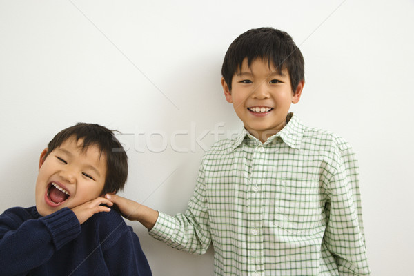 Young Asian brothers Stock photo © iofoto