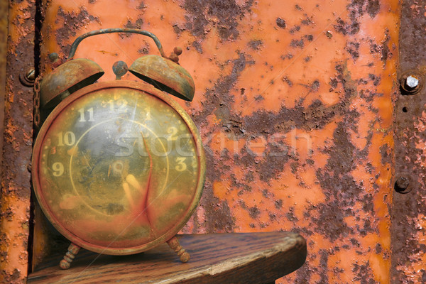 Alarm clock against orange. Stock photo © iofoto