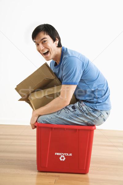 Man in recycling bin. Stock photo © iofoto