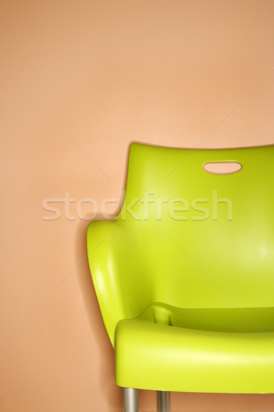 Zielone krzesło ściany plastikowe pomarańczowy projektu Zdjęcia stock © iofoto