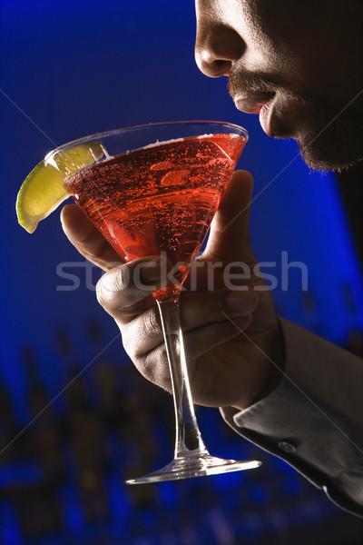 Homem potável martini africano americano para cima lábios Foto stock © iofoto