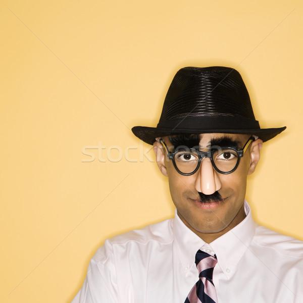 Homem africano americano máscara disfarçar cor Foto stock © iofoto