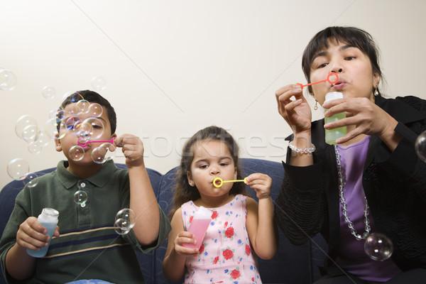 семьи сидят вместе мыльные пузыри Сток-фото © iofoto