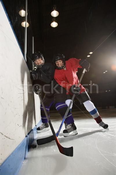 Nők játszik jégkorong játékosok harcol készít Stock fotó © iofoto