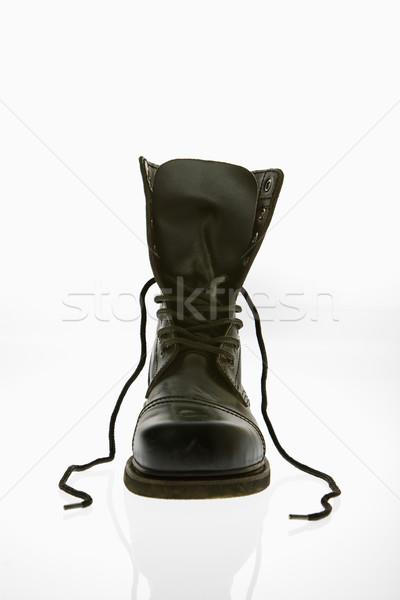 Harc csizma egy fekete bőr magas Stock fotó © iofoto