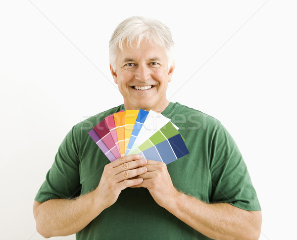 Man with paint swatches. Stock photo © iofoto