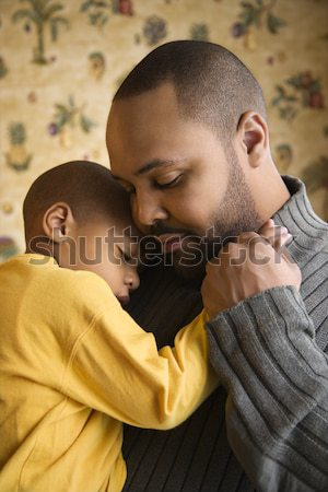 Stock photo: Father Smiling Holding Young Son