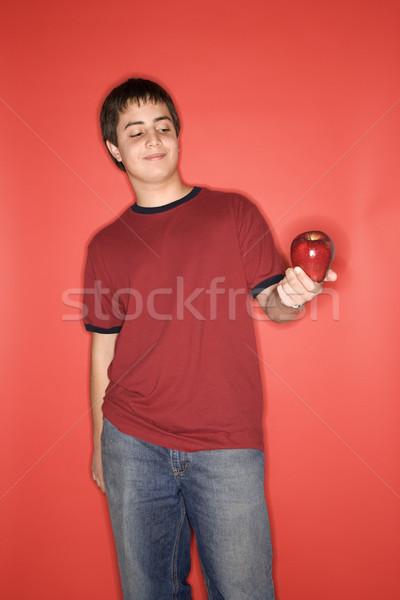 Teen boy holding apple. Stock photo © iofoto