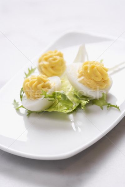 Ei voorgerechten drie eieren groene garnering Stockfoto © iofoto