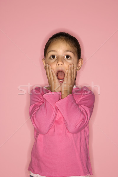 Girl with mouth open in surprise. Stock photo © iofoto
