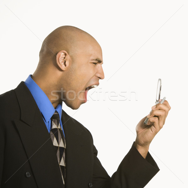 Man yelling at cellphone. Stock photo © iofoto