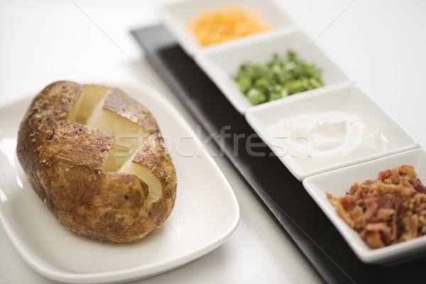Baked potato with toppings. Stock photo © iofoto