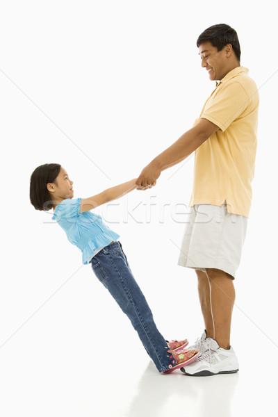 Figlia padre asian piedi piedi holding hands Foto d'archivio © iofoto
