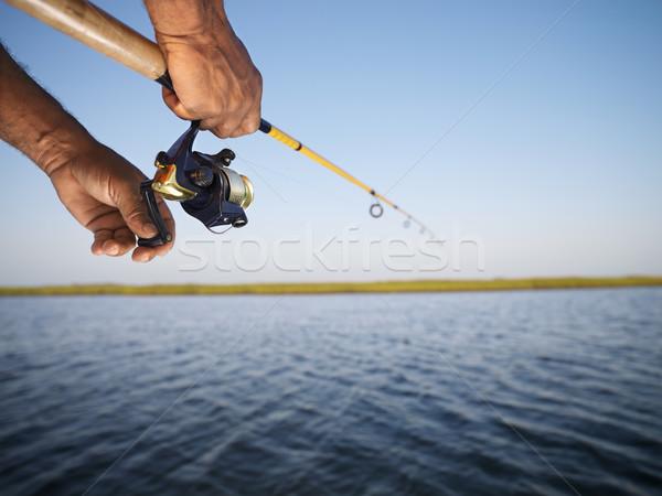 Mains canne à pêche Homme main canne à pêche Photo stock © iofoto