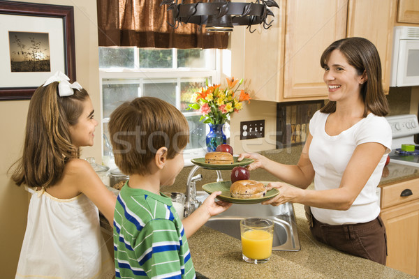 Mom giving kids breakfast. Stock photo © iofoto