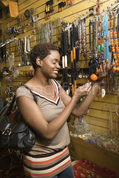Young African American Woman Shopping For Jewelry Stock photo © iofoto