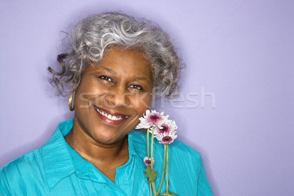Woman holding flowers. Stock photo © iofoto