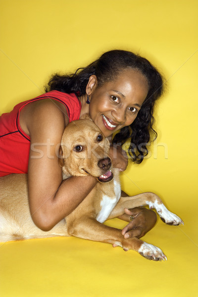 Smiling woman hugging dog. Stock photo © iofoto